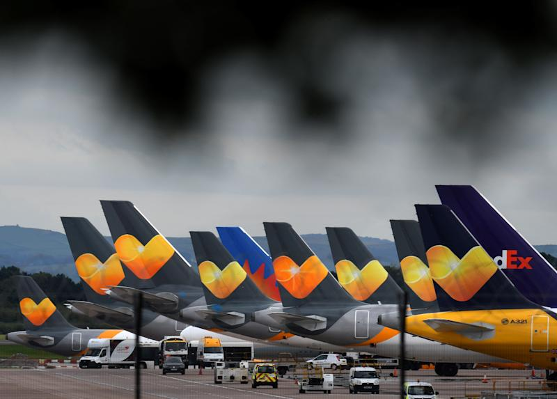 Thomas Cook logos are pictured on the tailfins of the company's passenger aircraft parked on tarmac at Manchester Airport in Manchester, northern England on September 23, 2019. Photo: OLI SCARFF/AFP/Getty Images