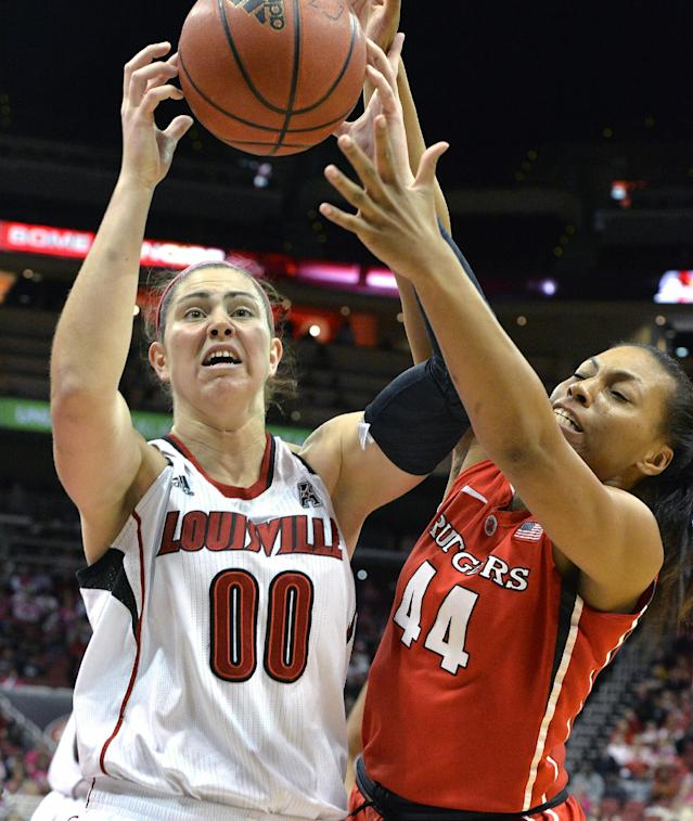 Louisville's Sara Hammond, left, battles Rutgers' Betnijah Laney for a rebound during the first half of an NCAA college basketball game, Sunday, Feb. 23, 2014, in Louisville, Ky. (AP Photo/Timothy D. Easley)