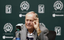 FILE - This May 30, 2017, file photo, shows Jack Nicklaus answering questions during a news conference a few days before the start of the Memorial golf tournament in Dublin, Ohio. The challenge for the PGA Tour is to make it feel different to the players who will be in Dublin, Ohio, the next two weeks. For the first time in 63 years, two PGA Tour events are being held on the same golf course in consecutive weeks. I think this week we're going to have to be a little bit cautious with the golf course, certainly out of respect to Mr. Nicklaus and the Memorial Tournament being next week, said Gary Young, the PGA Tour rules official overseeing the Workday Charity Open.(AP Photo/Jay LaPrete, File)
