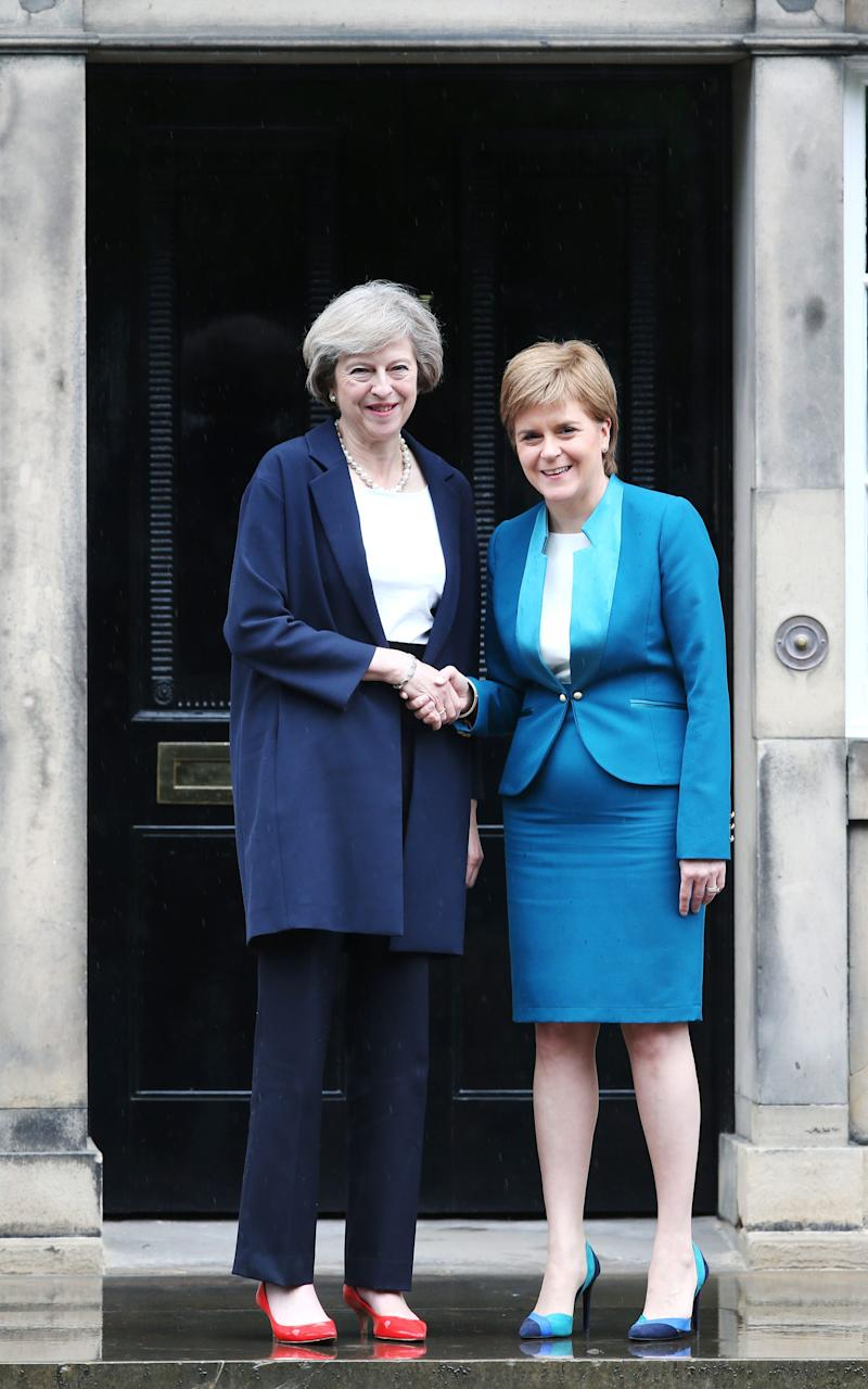 Theresa May is greeted by Nicola Sturgeon at Bute House in Edinburgh - Credit:  Andrew Milligan/PA