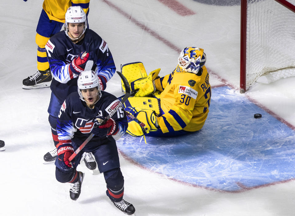 United States' Alex Turcotte (15) and Trevor Zegras (9) celebrate a goal as Sweden goalie Hugo Alnefelt (30) sits on the ice during the second period of an IIHF World Junior Hockey Championship game Thursday, Dec. 31, 2020, in Edmonton, Alberta. (Jason Franson/The Canadian Press via AP)