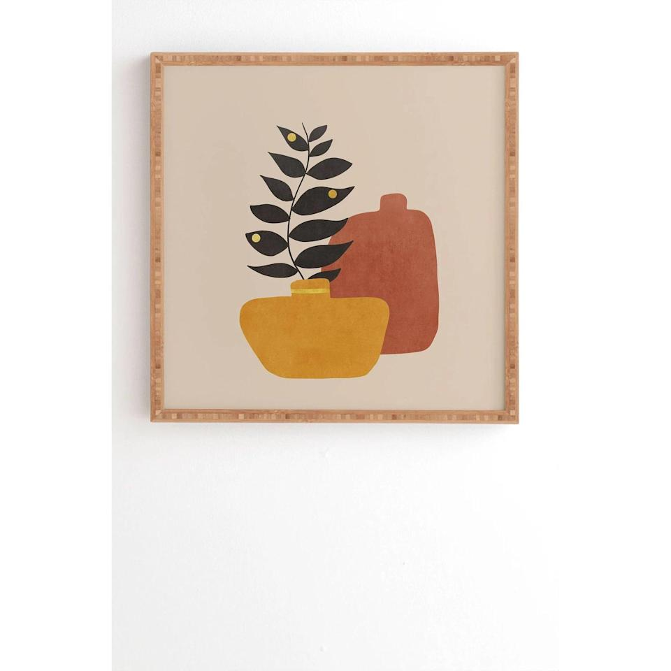 <p>Your print collection needs this <span>Viviana Gonzalez Plant in a Pot Framed Wall Art</span> ($85, originally $100).</p>