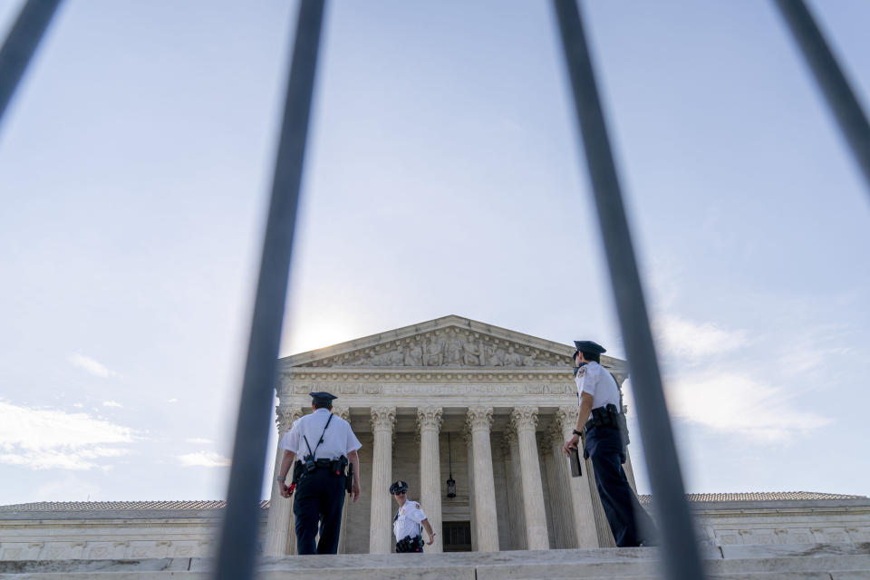 The Supreme Court is seen through a police barricade in Washington, Monday, June 7, 2021. (AP Photo/Andrew Harnik)