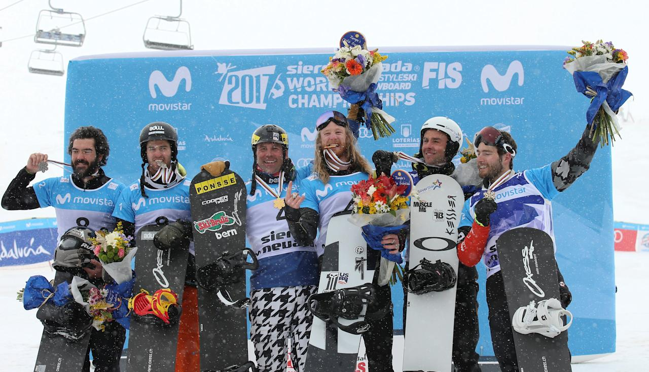 REFILE - CORRECTING IDENTITY OF TWO COMPETITORS   Snowboarding - FIS Snowboarding and Freestyle Skiing World Championships - Men's Team Snowboard Cross - Sierra Nevada, Spain - 13/03/17 (L to R) Silver medalists Regino Hernandez and Lucas Eguibar of Spain, gold medalists Nick Baumgartner and Hagen Kearney of the US and bronze medalists Kevin Hill and Chris Robanske of Canada celebrate during the presentation ceremony.    REUTERS/Albert Gea