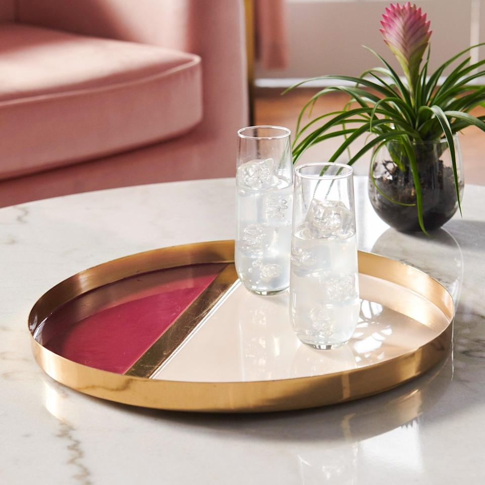 <p>Say yes to this cool <span>MoDRN Glam Multi Colored Decorative Tray</span> ($29).</p>