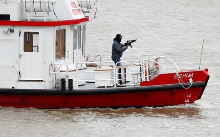 An actor playing an armed terrorist takes part in a training exercise by counter terrorism officers of the Metropolitan Police in a scenario to rescue hostages from a cruise boat on the river Thames, in London, Britain March 19, 2017.  REUTERS/Peter Nicholls