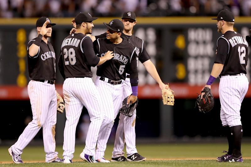 Trevor Story #28, Nolan Arenado #28, Carlos Gonzalez #5 and D.J. LeMahieu #9 of the Colorado Rockies celebrate their win against the Arizona Diamondbacks at Coors Field on June 20, 2017 in Denver, Colorado.