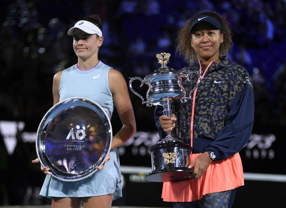 Japan's Naomi Osaka, right, holds the Daphne Akhurst Memorial Cup defeating United States Jennifer Brady, left, in the women's singles finalat the Australian Open tennis championship in Melbourne, Australia, Saturday, Feb. 20, 2021.(AP Photo/Andy Brownbill)