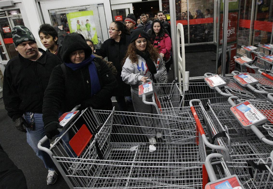 Unidentified shoppers rush into a Kmart in Chicago on Friday, Nov. 25, 2011. Black Friday began in earnest as stores opened their doors at midnight. Thousands of shoppers lined up at Macy's, Best Buy and other stores nationwide to buy everything from toys to tablets on Black Friday despite the economic downturn and some planned protests of the shopping holiday.(AP Photo/Nam Y. Huh)