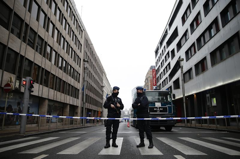 Belgian police officers stand guard near Maelbeek - Maalbeek subway station in Brussels on March 23, 2016, a day after triple bomb attacks in the Belgian capital (AFP Photo/Kenzo Tribouillard)