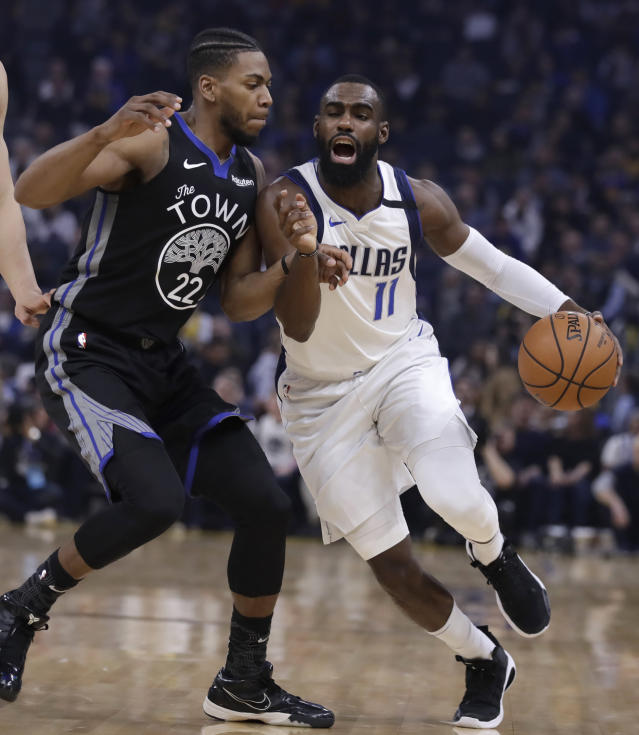 Dallas Mavericks' Tim Hardaway Jr., right, drives the ball against Golden State Warriors' Glenn Robinson III (22) in the first half of an NBA basketball game Tuesday, Jan. 14, 2020, in San Francisco. (AP Photo/Ben Margot)