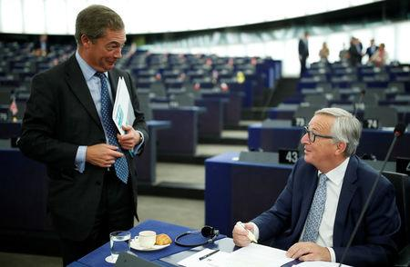 European Commission President Jean-Claude Juncker (R), talks with Nigel Farage, United Kingdom Independence Party (UKIP) member and MEP ahead of the State of the European Union debate at the European Parliament in Strasbourg, France, September 13, 2017.    REUTERS/Christian Hartmann