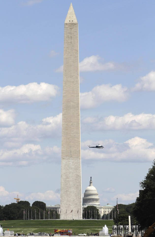 A US Park Service helicopter flies between the Washington Monument and the Capitol on the National Mall in Washington, Tuesday, Aug. 23, 2011, following an earthquake in the Washington area. A 5.9 magnitude earthquake centered in Virginia forced evacuations of all the monuments on the National Mall in Washington and rattled nerves from Georgia to Martha's Vineyard, the Massachusetts island where President Barack Obama is vacationing. No injuries were immediately reported. (AP Photo/Jacquelyn Martin)