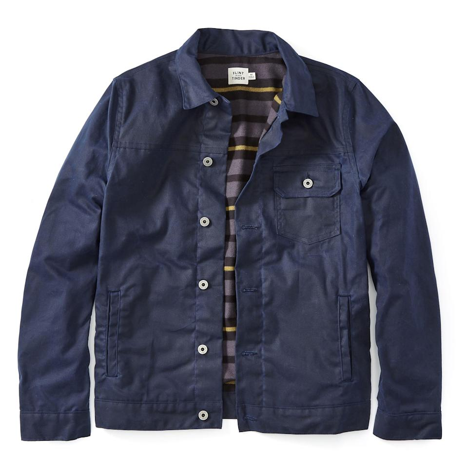 """<p><strong>Flint and Tinder</strong></p><p>huckberry.com</p><p><strong>$240.00</strong></p><p><a href=""""https://go.redirectingat.com?id=74968X1596630&url=https%3A%2F%2Fhuckberry.com%2Fstore%2Fflint-and-tinder%2Fcategory%2Fp%2F56476-flannel-lined-waxed-trucker-jacket&sref=https%3A%2F%2Fwww.esquire.com%2Fstyle%2Fmens-fashion%2Fg34487003%2Fhuckberry-fall-mens-essentials%2F"""" rel=""""nofollow noopener"""" target=""""_blank"""" data-ylk=""""slk:Buy"""" class=""""link rapid-noclick-resp"""">Buy</a></p><p>The classic trucker, now updated with a handsome flannel lining and done up in an inky navy color way you could genuinely lose yourself in staring at for too long. </p>"""