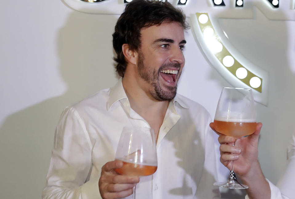 McLaren driver Fernando Alonso, of Spain, makes a toast during a promotion event made by one of his sponsors, in Sao Paulo, Brazil, Wednesday, Nov. 7, 2018. Alonso will compete Sunday in the Brazilian Formula One Grand Prix at Sao Paulo's Interlagos circuit. (AP Photo/Andre Penner)