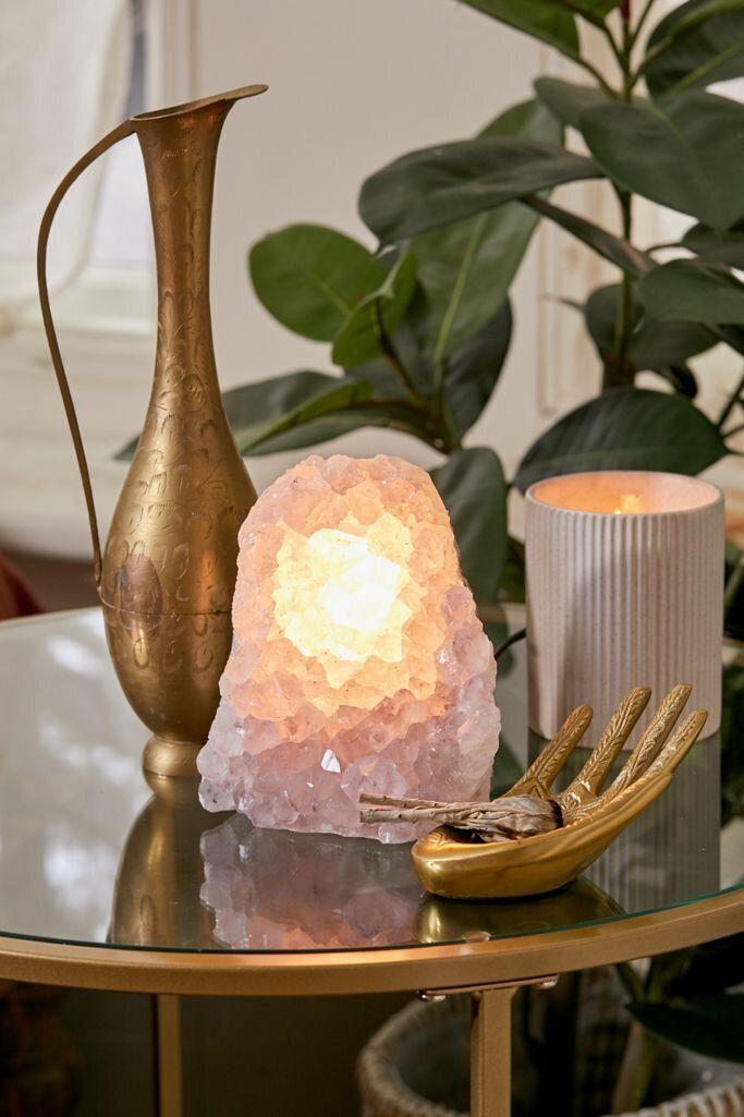 """This light won't be <i>too</i> bright: This amethyst crystal lamp isn't meant to be blinding, but will give enough of a glow. It's made from anatural amethyst crystal, so each lamp is one of a kind. The lamp can be plugged in, has an on/off switch and needs a <a href=""""https://amzn.to/2RvX4wo"""" target=""""_blank"""" rel=""""noopener noreferrer"""">6W candelabra bulb</a>.<a href=""""https://fave.co/32xoAQk"""" target=""""_blank"""" rel=""""noopener noreferrer"""">Find it for $74 at Urban Outfitters</a>."""