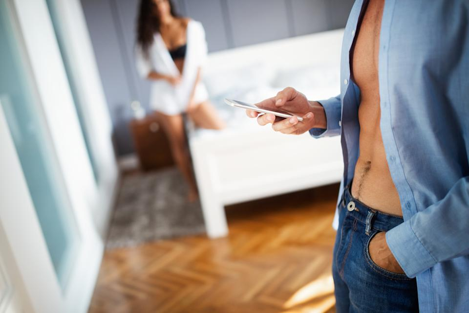 Woman discovering his boyfriend, husband cheating on the mobile phone