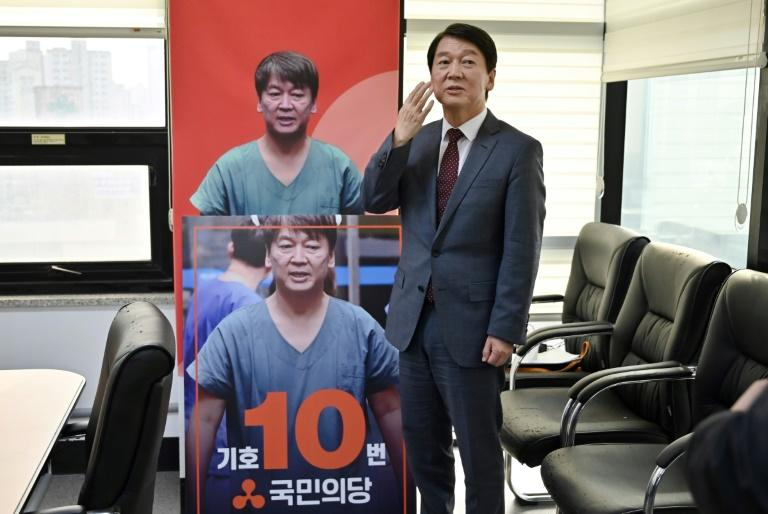 Ahn was treating up to 90 intensive care patients daily in Daegu, with pictures showing him looking drained in sweat-soaked medical scrubs (AFP Photo/Jung Yeon-je)