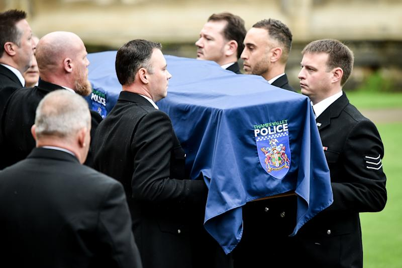The PC's coffin is draped in a police flag as it is carried into the church in Berkshire. (PA)