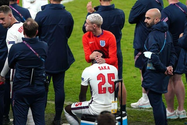 Saka is consled by England team-mate Phil Foden soon after his penalty miss at Wembley