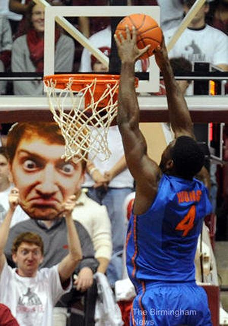 Alabama freshman Jack Blankenship added a new twist to the trend of giant celebrity head signs by waving a giant picture of his own funny face.