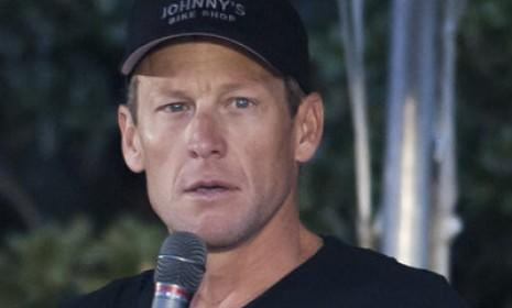 Lance Armstrong speaks before the Livestrong Challenge Ride in Austin on Oct. 21: The International Cycling Union announced Monday that it will strip the cyclist of his seven Tour de France titles for alleged doping.