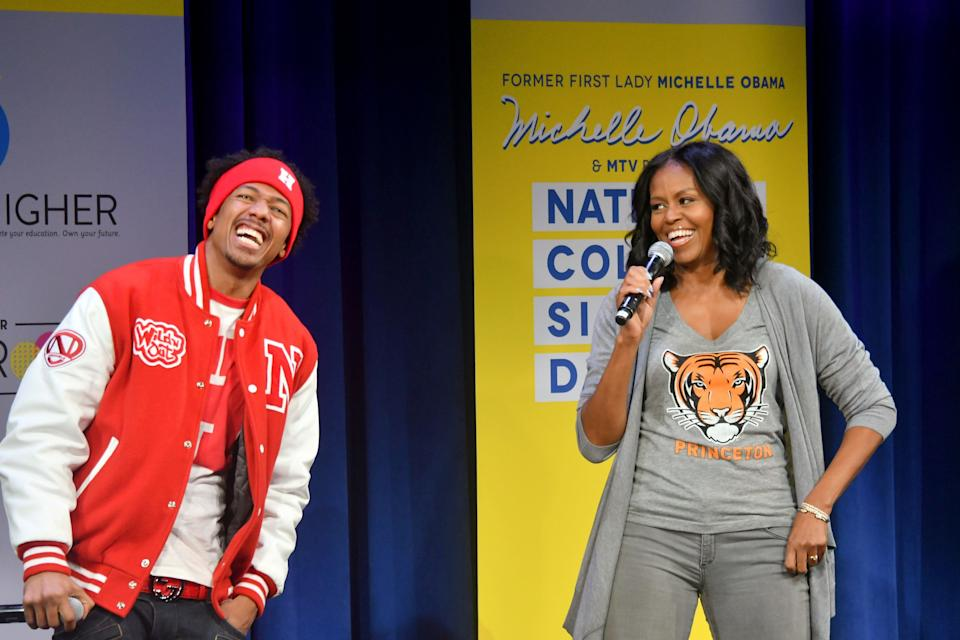NEW YORK, NY - MAY 05:  Nick Cannon (L) and Former First Lady Michelle Obama speak onstage during MTV's 2017 College Signing Day With Michelle Obama at The Public Theater on May 5, 2017 in New York City.  (Photo by Mike Coppola/Getty Images for MTV)