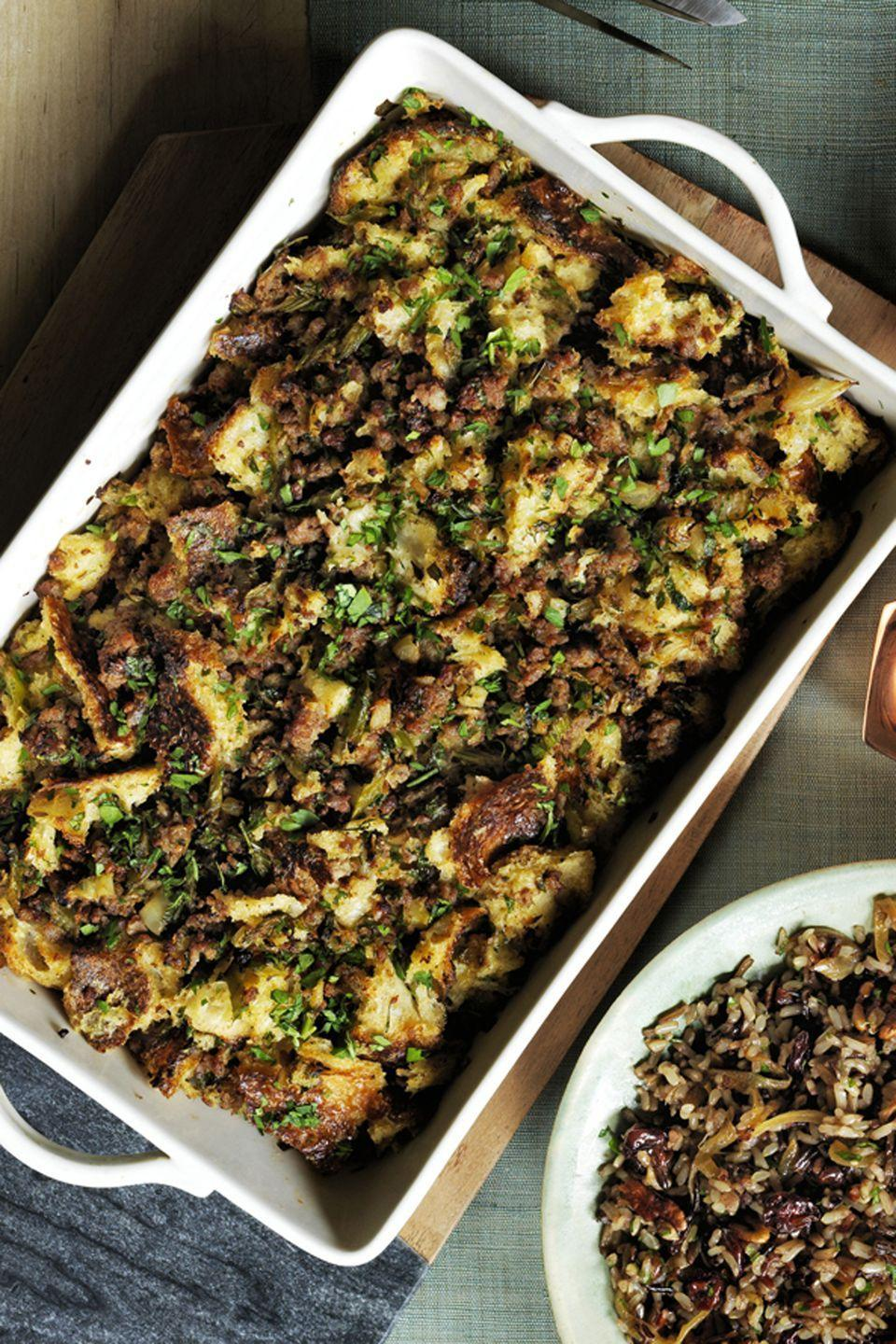 """<p>This sausage-filled stuffing is practically a meal in itself, but it makes for a tasty Thanksgiving side dish.</p><p><em><strong><a href=""""https://www.womansday.com/food-recipes/food-drinks/recipes/a60486/sourdough-stuffing-with-sausage-and-herbs-recipe/"""" rel=""""nofollow noopener"""" target=""""_blank"""" data-ylk=""""slk:Get the Sourdough Stuffing with Sausage and Herbs recipe."""" class=""""link rapid-noclick-resp"""">Get the Sourdough Stuffing with Sausage and Herbs recipe.</a></strong></em> </p>"""