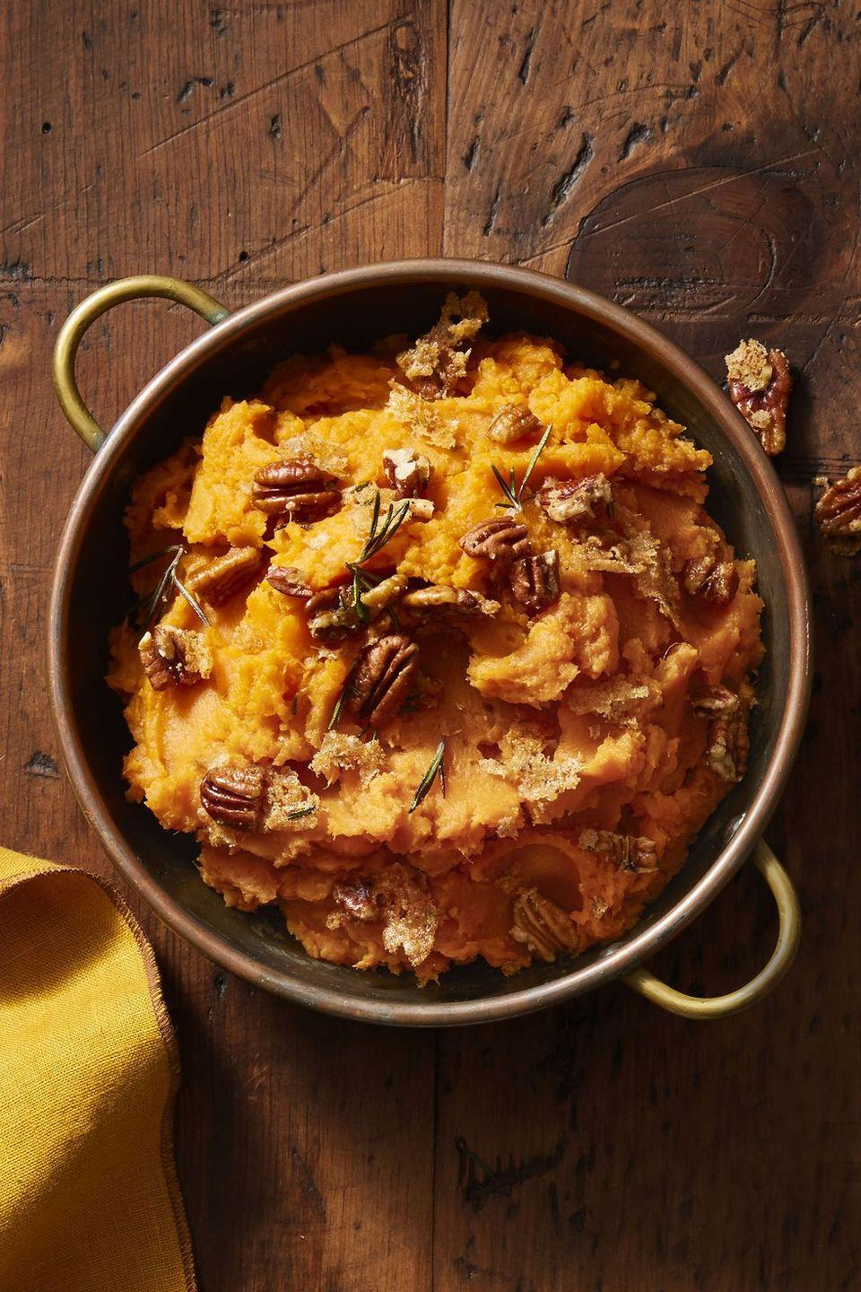 """<p>Just add pure maple syrup, pecans, and fresh rosemary to your mashed sweet potatoes to transform them into a 5-star side dish your guests will remember for years to come. </p><p><em><strong>Get the recipe at <a href=""""https://www.goodhousekeeping.com/food-recipes/easy/a46618/rosemary-pecan-mashed-sweet-potatoes-recipe/"""" rel=""""nofollow noopener"""" target=""""_blank"""" data-ylk=""""slk:Good Housekeeping"""" class=""""link rapid-noclick-resp"""">Good Housekeeping</a>.</strong></em></p>"""