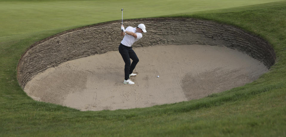 Northern Ireland's Rory McIlroy plays out of a bunker on the 6th green during the first round British Open Golf Championship at Royal St George's golf course Sandwich, England, Thursday, July 15, 2021. (AP Photo/Peter Morrison)