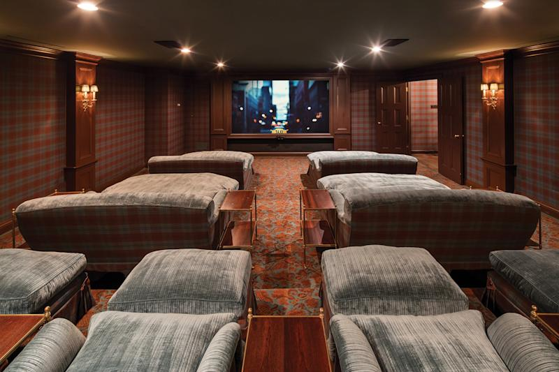 This home movie theater comes complete with bedlike couches.