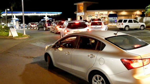 PHOTO: Cars line up late at night to fill up with gas as Hurricane Lane approaches Honolulu, Aug. 21, 2018. (Hugh Gentry/Reuters)