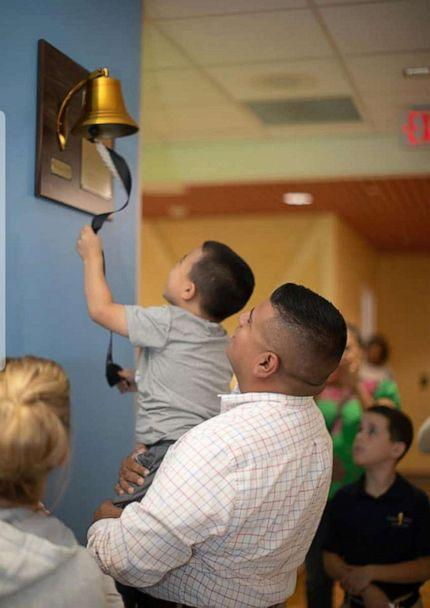 PHOTO: Gabe Rodriguez rings the bell with his father after beating leukemia. (Katie Rodriguez)