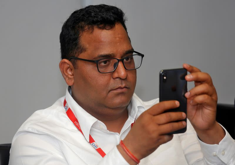 FILE PHOTO: Vijay Shekhar Sharma, founder of Paytm's parent One97 Communications, checks his mobile phone before the launch of a Citibank and Paytm credit card in Mumbai