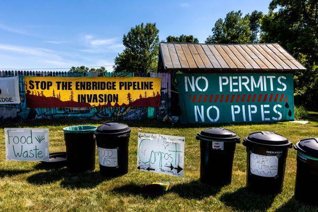 Pipeline protest signs form a backdrop to waste segregation bins at a campsite on the White Earth Nation Reservation near Waubun, Minnesota, on June 5. (Photo: KEREM YUCEL via Getty Images)