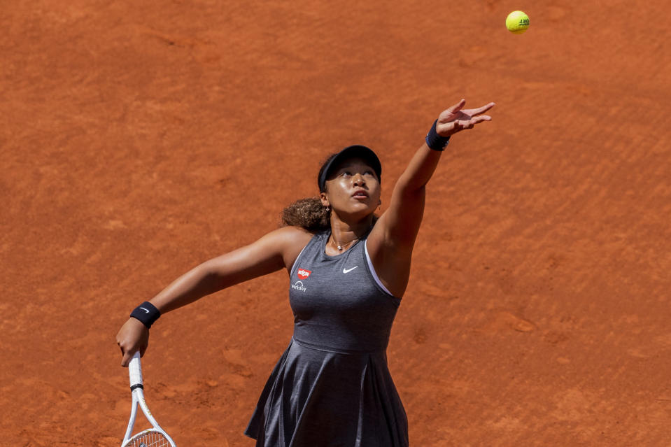 Japan's Naomi Osaka, serves to Japan's Misaki Doi during their match at the Mutua Madrid Open tennis tournament in Madrid, Spain, Friday, April 30, 2021. (AP Photo/Bernat Armangue)