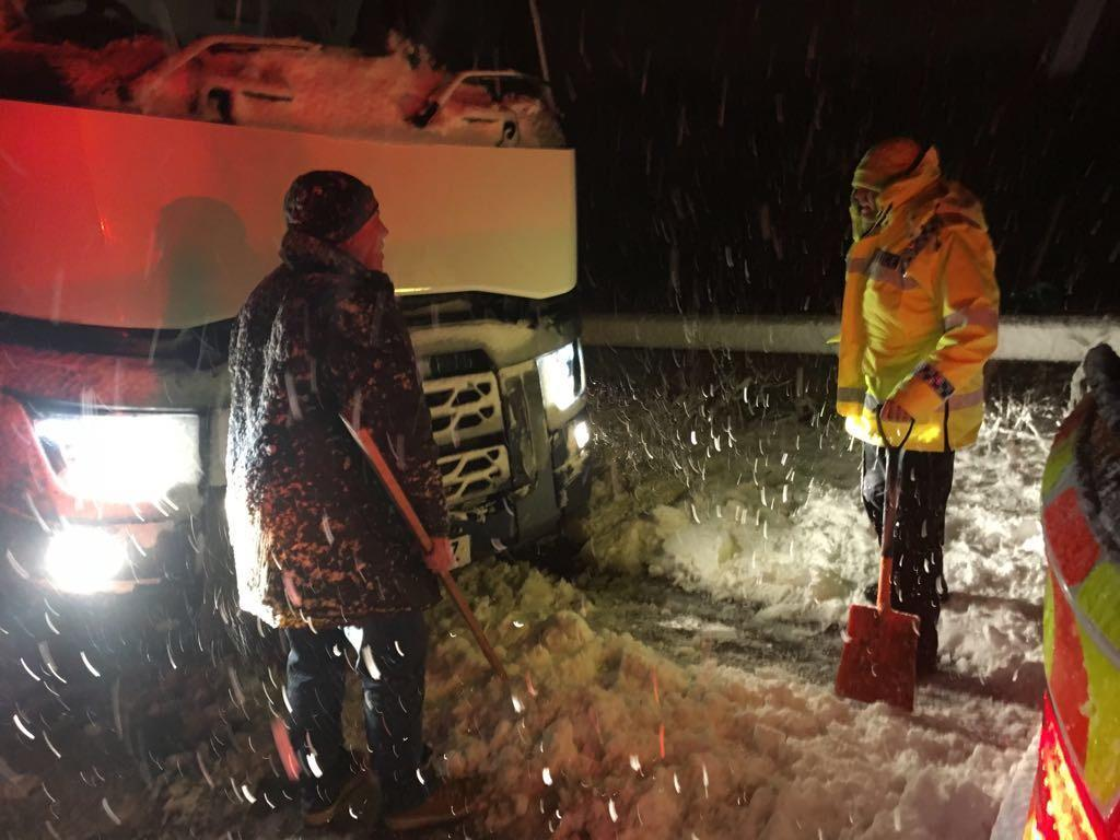 <p>Picture taken from the Twitter feed of Gloucestershire Constabulary of police at the scene of a lorry that jack-knifed on the M5 Junction 11A after wintry weather swept across the country. (PA) </p>