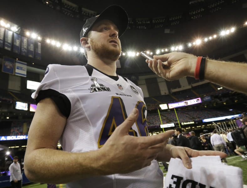 Baltimore Ravens long snapper Morgan Cox is interviewed during media day for the NFL Super Bowl XLVII football game Tuesday, Jan. 29, 2013, in New Orleans. (AP Photo/Pat Semansky)