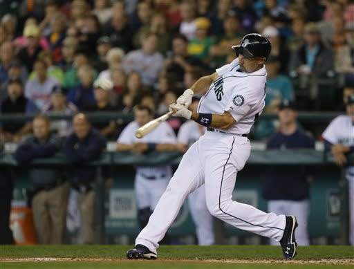 Seattle Mariners' Raul Ibanez hits a two-run home run in the first inning of a baseball game against the Oakland Athletics, Sunday, June 23, 2013, in Seattle. (AP Photo/Ted S. Warren)