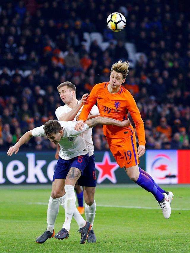 Soccer Football - International Friendly - Netherlands vs England - Johan Cruijff Arena, Amsterdam, Netherlands - March 23, 2018 England's John Stones and Eric Dier in action with Netherlands' Wout Weghorst REUTERS/Michael Kooren