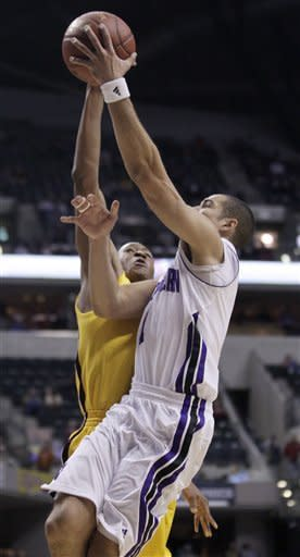 Minnesota forward Rodney Williams, left, rejects a shot by Northwestern guard/forward Drew Crawford in the first half of an NCAA college basketball game at the first round of the Big Ten Conference tournament in Indianapolis, Thursday, March 8, 2012. (AP Photo/Michael Conroy)