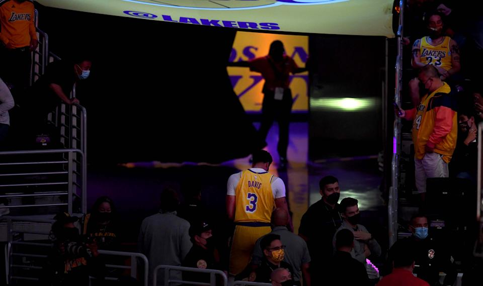 Back view of Anthony Davis walking down the tunnel toward the locker room.