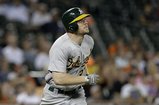 Oakland Athletics' Brandon Moss watches his three-run home run against the Detroit Tigers in the eighth inning of a baseball game in Detroit, Wednesday, Aug. 28, 2013. (AP Photo/Paul Sancya)