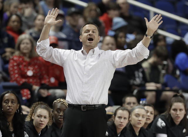 Louisville head coach Jeff Walz directs his team against Clemson during the first half of an NCAA college basketball game in the Atlantic Coast Conference women's tournament in Greensboro, N.C., Friday, March 8, 2019. (AP Photo/Chuck Burton)