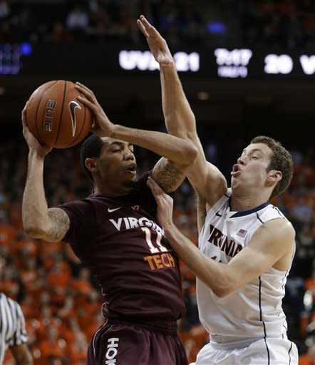 Virginia Tech guard Erick Green (11) works against Virginia forward Evan Nolte during the first half of an NCAA college basketball game Tuesday, Feb. 12, 2013, in Charlottesville, Va. (AP Photo/Steve Helber)