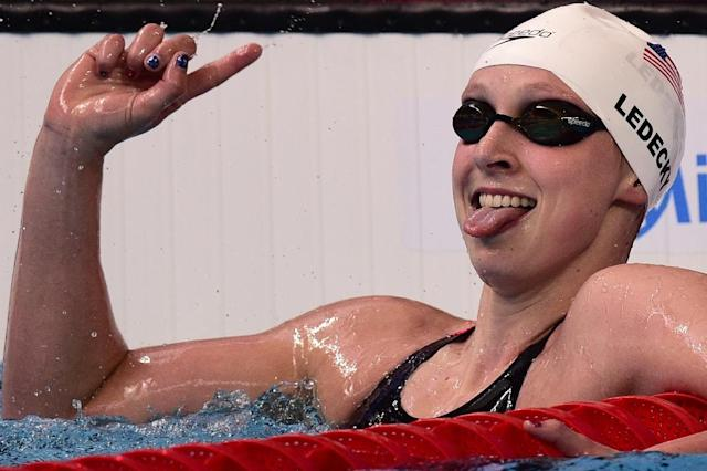 Katie Ledecky celebrates after setting a new world record during the heats for the women's 1500m freestyle swimming event at the world championships in Kazan, on August 3, 2015 (AFP Photo/Martin Bureau)