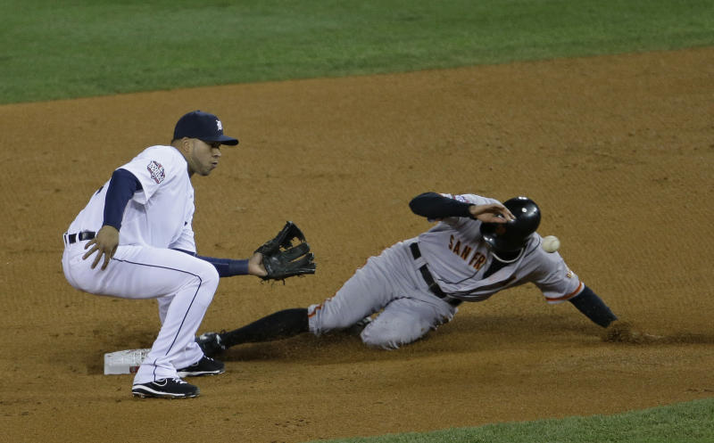San Francisco Giants' Hunter Pence steals second as Detroit Tigers' Jhonny Peralta takes the throw during the second inning of Game 3 of baseball's World Series Saturday, Oct. 27, 2012, in Detroit. (AP Photo/Patrick Semansky)