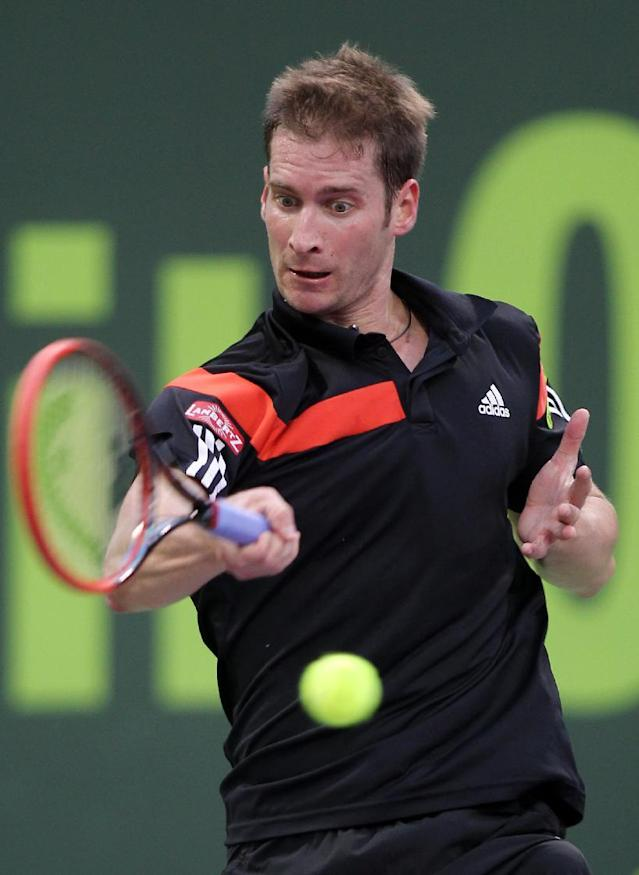 Florian Mayer of Germany returns the ball to Andy Murray of Great Britain during the Qatar ATP Open Tennis tournament in Doha, Qatar, Wednesday, Jan. 1, 2014. (AP Photo/Osama Faisal)