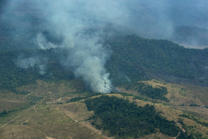 FILE - In this Wednesday, Aug. 28, 2019 file photo, smoke rises from a rainforest in Altamira, Para state, Brazil. A decade-long effort by the world to save the world's disappearing species and declining ecosystems has mostly failed so far, with fragile ecosystems like coral reefs and tropical forests in even more trouble than ever, according to a United Nations biodiversity report released on Tuesday, Sept. 15, 2020. (AP Photo/Leo Correa)
