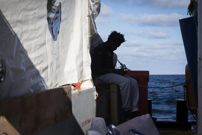 In this Monday, Dec. 24, 2018 photo and provided by Sea Watch, a migrants sits aboard the rescue ship Sea-Watch 3. Over 30 migrants saved in the central Mediterranean sea by the German no-profit rescue organization Sea-Watch are still stranded after five days at sea, because no European country is opening its ports to receive them. (Chris Grodotzki/Sea Watch Via AP)